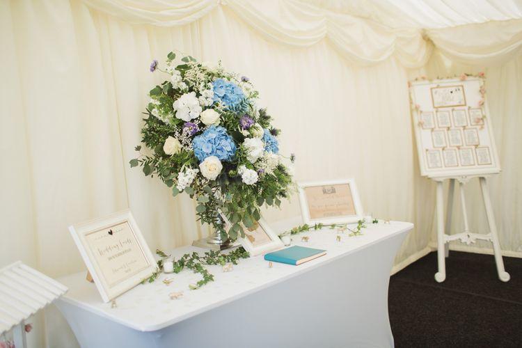 Guest Table with Blue & white Floral Arrangement