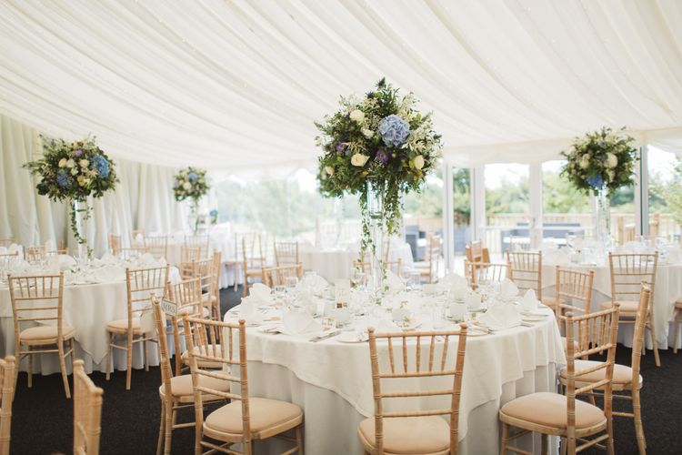 Marquee Wedding Breakfast Reception with Tall Blue & White Floral Centrepieces