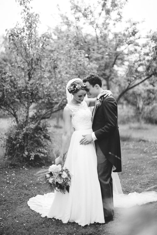 Bride in Lace Bodice & Ingrida Bridal Wedding Dress with Blue & White Hydrangea & Stock Bouquet and Groom in Traditional Morning Suit
