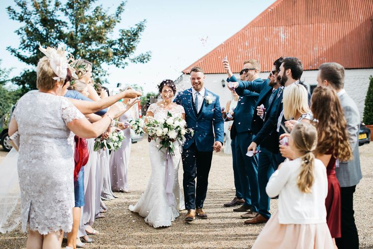 Confetti Moment   Bride in Justin Alexander Gown   Groom in Blue Check Hugo Boss Suit   White & Green Reception at The Red Barn, Kent   Olegs Samsonovs Photography