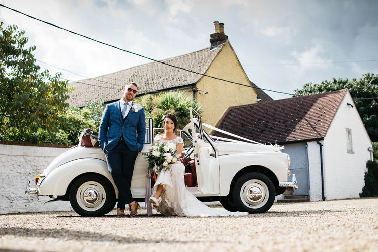 Wedding Car   Bride in Justin Alexander Gown   Groom in Blue Check Hugo Boss Suit   White & Green Reception at The Red Barn, Kent   Olegs Samsonovs Photography