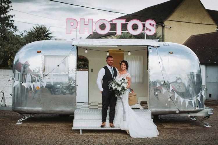 Photo Booth   Bride in Justin Alexander Gown   Groom in Blue Check Hugo Boss Suit   White & Green Reception at The Red Barn, Kent with Balloon Decor   Olegs Samsonovs Photography