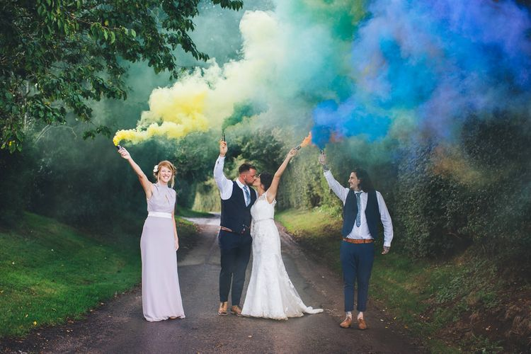 Smoke Bombs   Bride in Justin Alexander Gown   Groom in Blue Check Hugo Boss Suit   White & Green Reception at The Red Barn, Kent with Balloon Decor   Olegs Samsonovs Photography