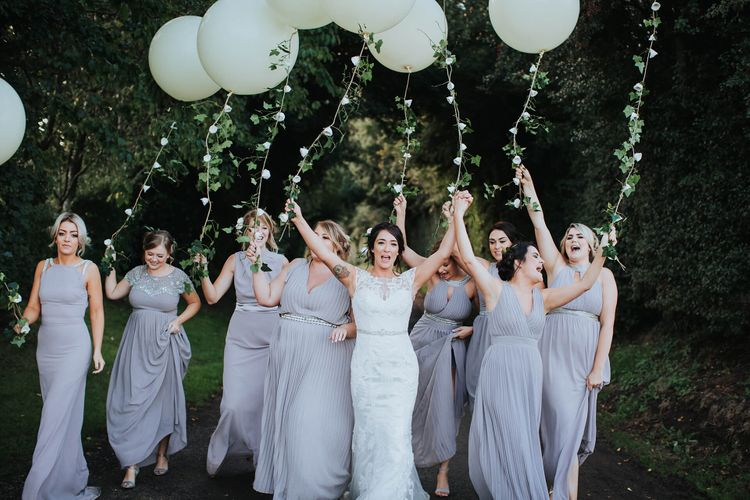 Giant Balloons   Bridesmaids in TFNC Bridesmaid Dresses   Bride in Justin Alexander Gown   White & Green Reception at The Red Barn, Kent   Olegs Samsonovs Photography