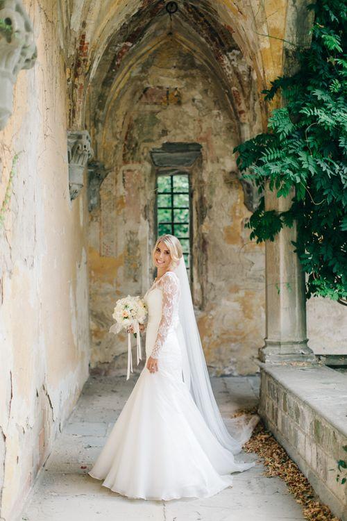 Bride in Suzanne Neville Victoriana Wedding Dress