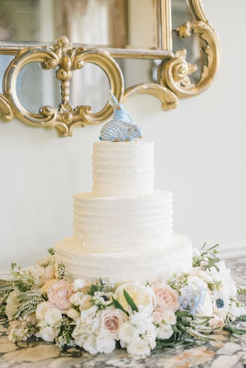 Elegant White Wedding Cake with Floral Skirt | Classic Blue & White Wedding at Prestwold Hall in Loughborough | Georgina Harrison Photography