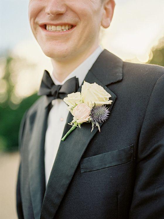 Buttonhole | Groom in Black Tuxedo | Classic Blue & White Wedding at Prestwold Hall in Loughborough | Georgina Harrison Photography