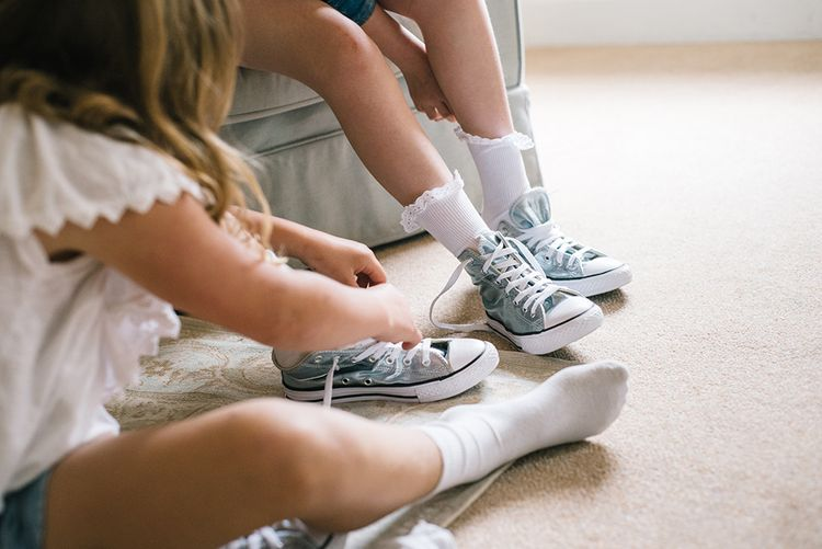 Flower Girls with Blue Converse Trainers | Classic Blue & White Wedding at Prestwold Hall in Loughborough | Georgina Harrison Photography