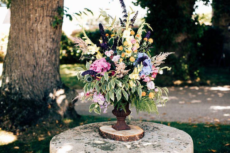 Stunning Floral Arrangement In Urn