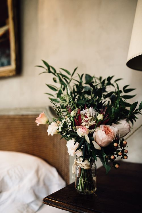 Protea, David Austin Rose, Thistle & Foliage Bouquet | Outdoor Destination Wedding at Château De Malliac Planned by Country Weddings in France | Styling by The Hand-Painted Bride | Samuel Docker Photography | Marriage in Motion Films
