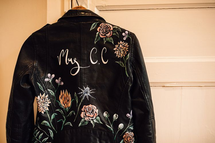 Customised Bridal Leather Jacket | Outdoor Destination Wedding at Château De Malliac Planned by Country Weddings in France | Styling by The Hand-Painted Bride | Samuel Docker Photography | Marriage in Motion Films