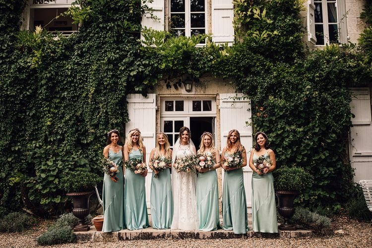 Bridesmaids in Mint Green Dresses | Bride in Lace Yolan Cris Gown | Outdoor Destination Wedding at Château De Malliac Planned by Country Weddings in France | Styling by The Hand-Painted Bride | Samuel Docker Photography | Marriage in Motion Films