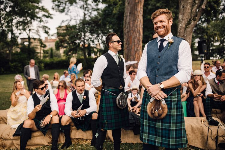 Groom at the Altar in a Tartan Kilt | Outdoor Destination Wedding at Château De Malliac Planned by Country Weddings in France | Styling by The Hand-Painted Bride | Samuel Docker Photography | Marriage in Motion Films