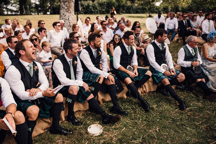 Wedding Ceremony | Groomsmen in Slater Tartan Kilts | Outdoor Destination Wedding at Château De Malliac Planned by Country Weddings in France | Styling by The Hand-Painted Bride | Samuel Docker Photography | Marriage in Motion Films