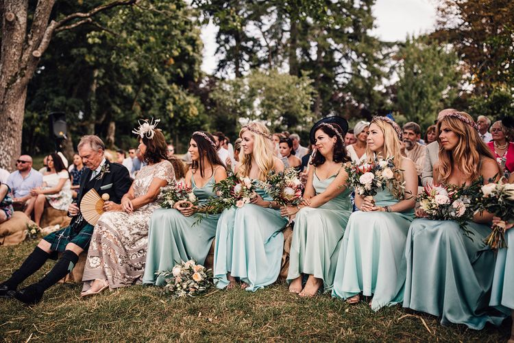 Wedding Ceremony | Bridesmaids in Mint Green Satin Dresses | Outdoor Destination Wedding at Château De Malliac Planned by Country Weddings in France | Styling by The Hand-Painted Bride | Samuel Docker Photography | Marriage in Motion Films