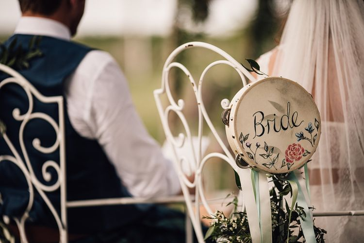Hand Painted Tamborine | Wedding Ceremony | Bride in Lace Yolan Cris Gown | Groom in Tartan Kilt | Outdoor Destination Wedding at Château De Malliac Planned by Country Weddings in France | Styling by The Hand-Painted Bride | Samuel Docker Photography | Marriage in Motion Films