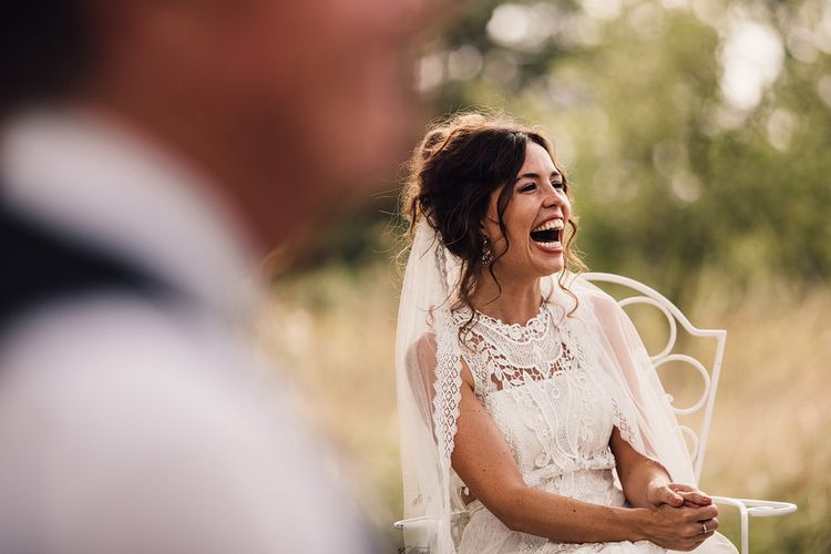 Wedding Ceremony | Bride in Lace Yolan Cris Gown | Outdoor Destination Wedding at Château De Malliac Planned by Country Weddings in France | Styling by The Hand-Painted Bride | Samuel Docker Photography | Marriage in Motion Films
