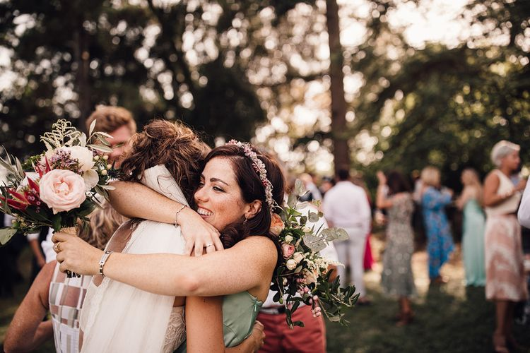 Wedding Hugs | Outdoor Destination Wedding at Château De Malliac Planned by Country Weddings in France | Styling by The Hand-Painted Bride | Samuel Docker Photography | Marriage in Motion Films