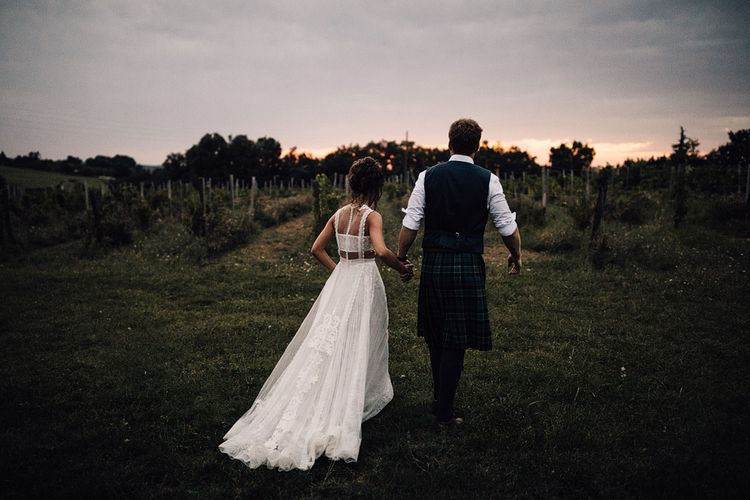Golden Hour | Bride in Yolan Cris Lace Gown | Groom in Tartan Kilt | Outdoor Destination Wedding at Château De Malliac Planned by Country Weddings in France | Styling by The Hand-Painted Bride | Samuel Docker Photography | Marriage in Motion Films