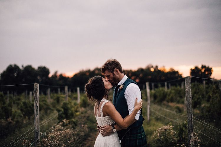 Sunset | Bride in Yolan Cris Lace Gown | Groom in Tartan Kilt | Outdoor Destination Wedding at Château De Malliac Planned by Country Weddings in France | Styling by The Hand-Painted Bride | Samuel Docker Photography | Marriage in Motion Films