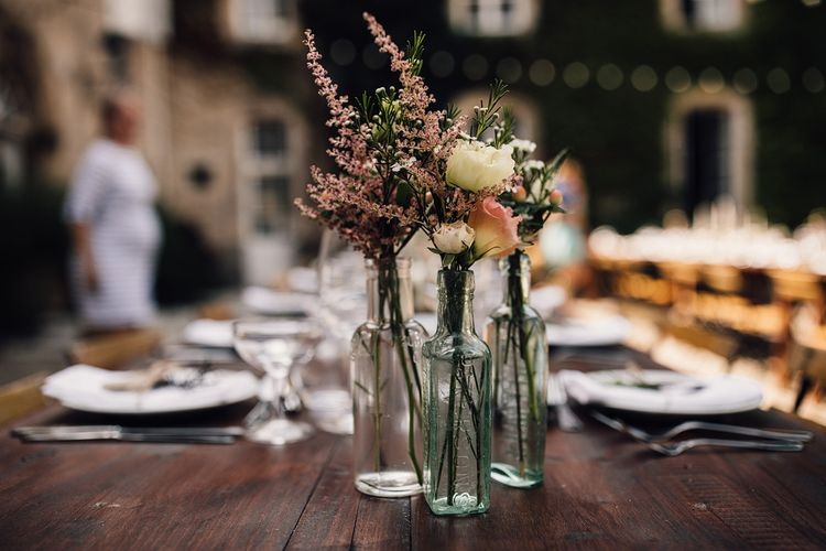 Flower Stems in Bottles | Outdoor Destination Wedding at Château De Malliac Planned by Country Weddings in France | Styling by The Hand-Painted Bride | Samuel Docker Photography | Marriage in Motion Films