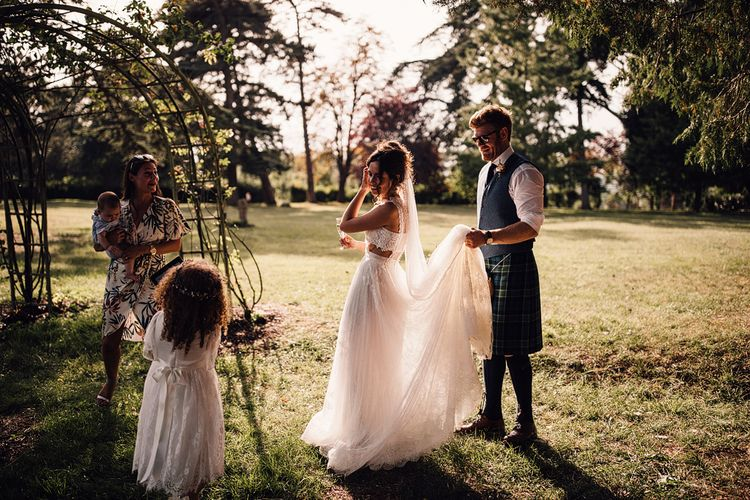 Bride in Yolan Cris Gown | Groom in Tatan Kilt | Outdoor Destination Wedding at Château De Malliac Planned by Country Weddings in France | Styling by The Hand-Painted Bride | Samuel Docker Photography | Marriage in Motion Films