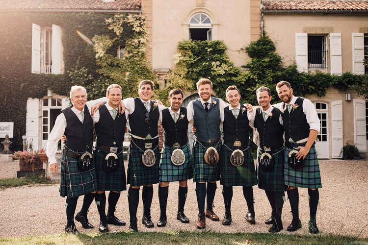 Groomsmen in Slaters Tartan Kilts | Outdoor Destination Wedding at Château De Malliac Planned by Country Weddings in France | Styling by The Hand-Painted Bride | Samuel Docker Photography | Marriage in Motion Films