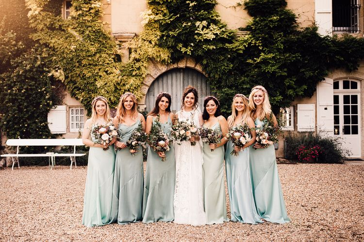 Bridesmaids in Mint Green Satin Dresses | Bride in Yolan Cris Lace Gown | Outdoor Destination Wedding at Château De Malliac Planned by Country Weddings in France | Styling by The Hand-Painted Bride | Samuel Docker Photography | Marriage in Motion Films
