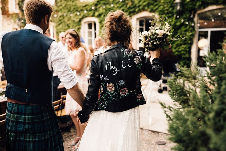 Bride in Yolan Cris Lace Gown & Leather Jacket | Outdoor Destination Wedding at Château De Malliac Planned by Country Weddings in France | Styling by The Hand-Painted Bride | Samuel Docker Photography | Marriage in Motion Films