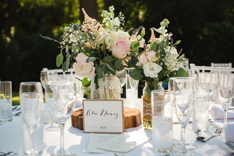 rustic Tree Slice & Flowers in Jars Centrepiece   Planned by Rachel Rose Weddings   Radka Horvath Photography