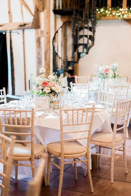 Romantic Peach & Coral Floral Centrepiece | Peach & Coral Country Wedding at Crabbs Barn, Essex | Kathryn Hopkins Photography | Film by Colbridge Media Services Ltd