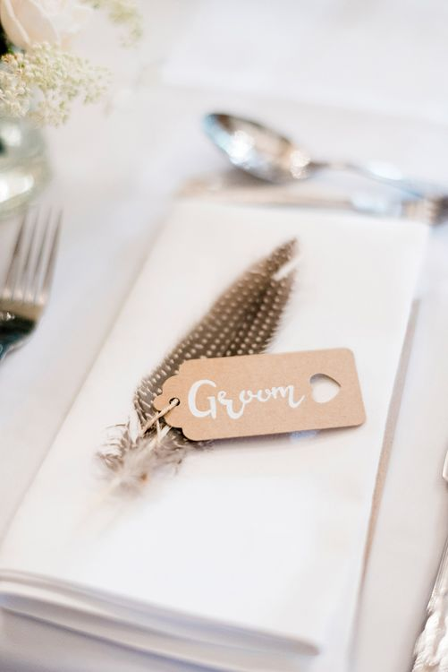 Kraft Place Name Tag & Feather Wedding Decor | Romantic Peach & Coral Floral Centrepiece | Peach & Coral Country Wedding at Crabbs Barn, Essex | Kathryn Hopkins Photography | Film by Colbridge Media Services Ltd