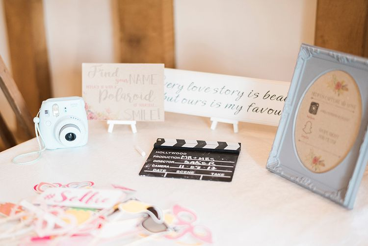 Polaroid Picture Guest Book Station | Romantic Peach & Coral Floral Centrepiece | Peach & Coral Country Wedding at Crabbs Barn, Essex | Kathryn Hopkins Photography | Film by Colbridge Media Services Ltd