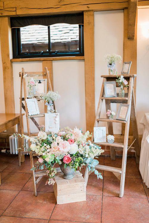 Vintage Step Ladders, Wooden Crate & Blush Floral Arrangement Wedding Decor | Romantic Peach & Coral Floral Centrepiece | Peach & Coral Country Wedding at Crabbs Barn, Essex | Kathryn Hopkins Photography | Film by Colbridge Media Services Ltd