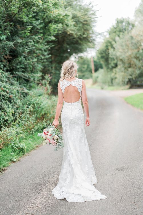 Bride in Lace Enzoani 'Inaru' Bridal Gown with Keyhole Back | Romantic Pink & Coral Bouquet with Roses & Dahlias | Peach & Coral Country Wedding at Crabbs Barn, Essex | Kathryn Hopkins Photography | Film by Colbridge Media Services Ltd