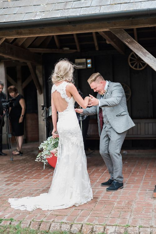 Bride in Lace Enzoani 'Inaru' Bridal Gown | Groom in Grey Wool Master Debonair Suit | Pink & Coral Country Wedding at Crabbs Barn, Essex | Kathryn Hopkins Photography | Film by Colbridge Media Services Ltd