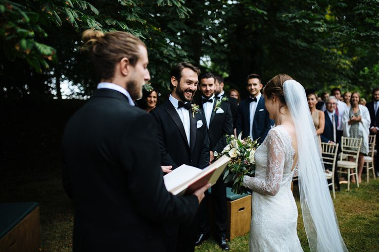 Outdoor Wedding Ceremony at Childerley Hall | Bride in Lace Sottero & Midgley Gown | Groom in Herrvon Eden Tuxedo | Tawny Photo