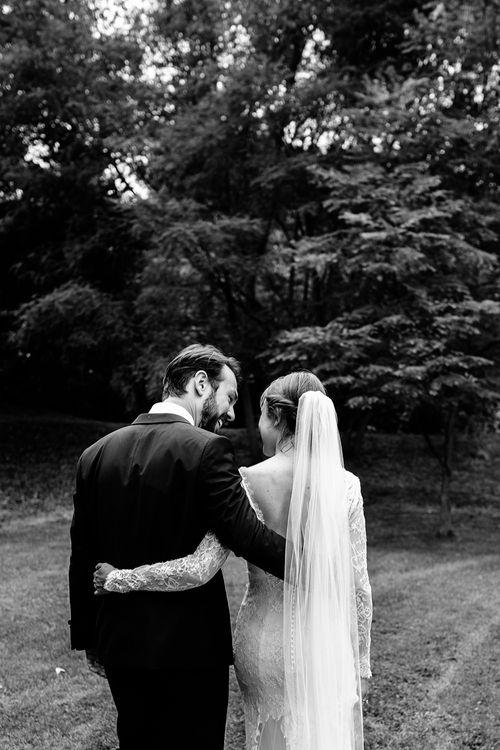 Bride in Lace Sottero & Midgley Gown | Groom in Herrvon Eden Tuxedo | Tawny Photo