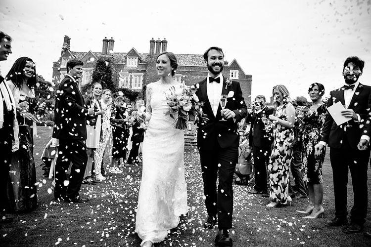 Confetti Moment | Childerley Hall Wedding | Bride in Lace Sottero & Midgley Gown | Groom in Herrvon Eden Tuxedo | Tawny Photo
