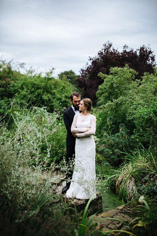 Childerley Hall Wedding | Bride in Lace Sottero & Midgley Gown | Groom in Herrvon Eden Tuxedo | Tawny Photo