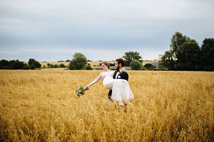 Bride in Maggie Sottero Lace Gown | Groom in Herrvon Eden Tuxedo | Tawny Photo