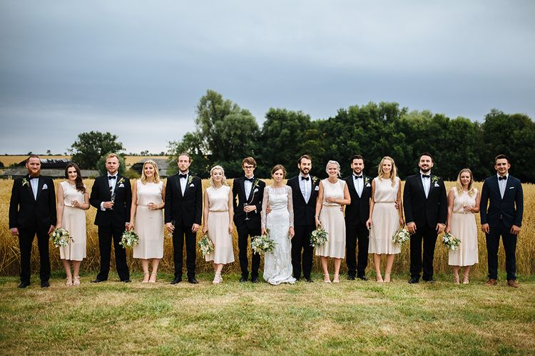 Wedding Party | Bride in Maggie Sottero Lace Gown | Groom in Herrvon Eden Tuxedo | Tawny Photo
