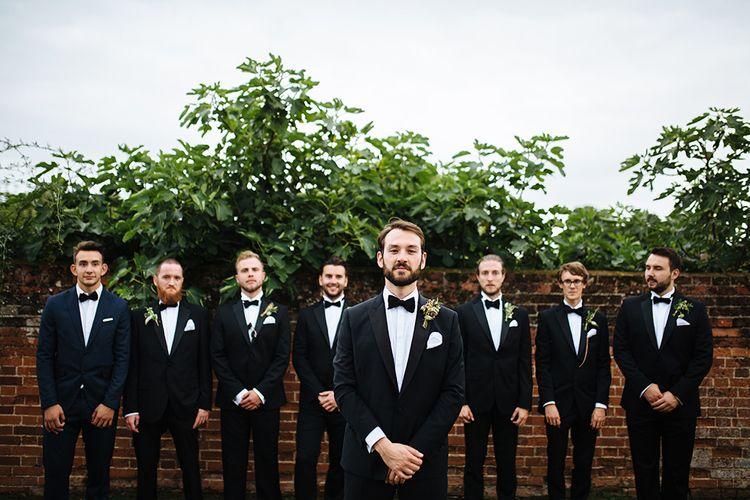 Groom in Herrvon Eden Tuxedo | Groomsmen in Marks and Spencer Tuxedo | Tawny Photo
