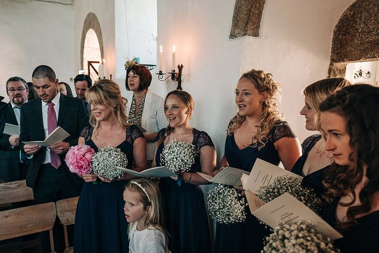 Wedding Ceremony   Bridesmaid in Navy ASOS Dresses with Gypsophila Bouquets   Isles of Scilly Wedding   Jason Mark Harris Photography