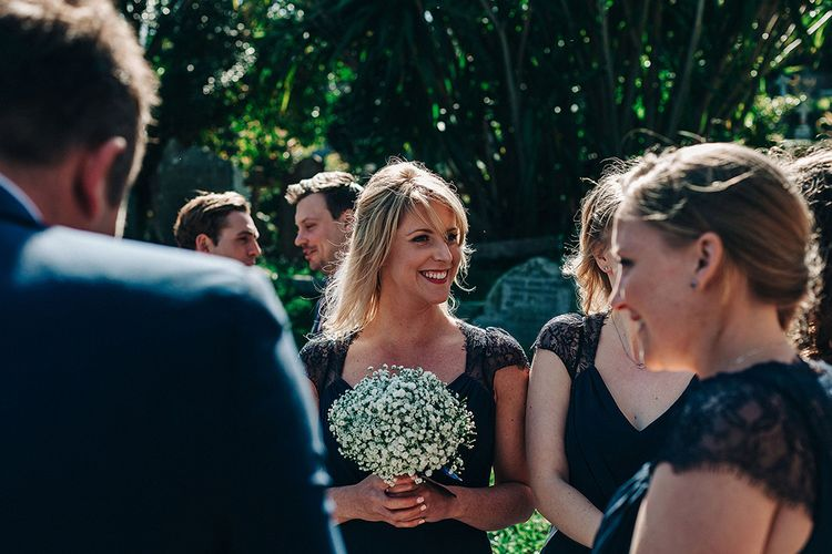 Bridesmaids in Navy ASOS Dresses with Gypsophila Bouquets   Isles of Scilly Wedding   Jason Mark Harris Photography