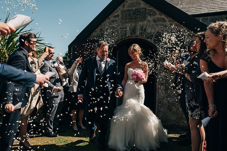 Confetti Moment   Bride in Pronovias Wedding Dress   Groom in Navy Ted Baker Suit   Isles of Scilly Wedding   Jason Mark Harris Photography