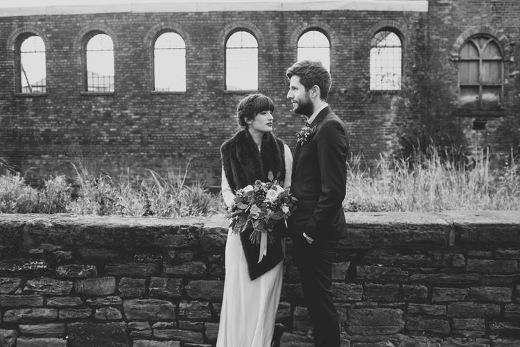 Bride in Ghost with Faux Fur Wrap & Groom In Reiss