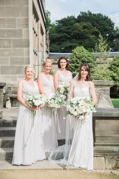 Bridesmaids in Grey Dessy Dresses | Bride in Jenny Packham | Elegant Hampton Manor Wedding with Floral Decor | Xander & Thea Fine Art Wedding Photography