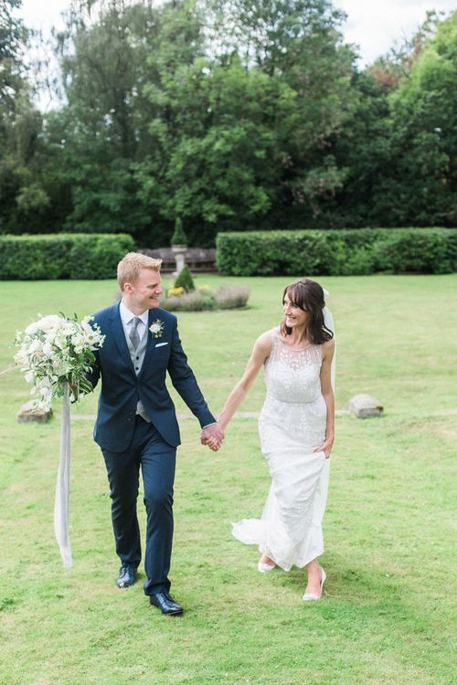 Bride in Jenny Packham | Groom in Navy Reiss Suit | Elegant Hampton Manor Wedding with Floral Decor | Xander & Thea Fine Art Wedding Photography