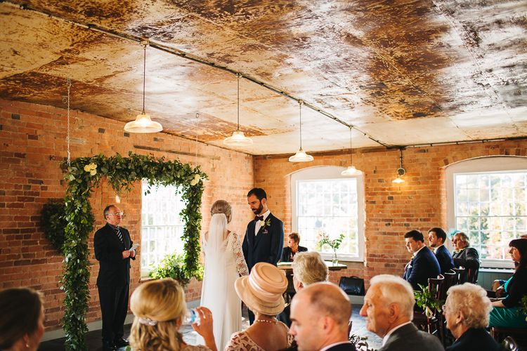 Industrial Wedding Ceremony at The West Mill | Greenery Flower Arch | S6 Photography
